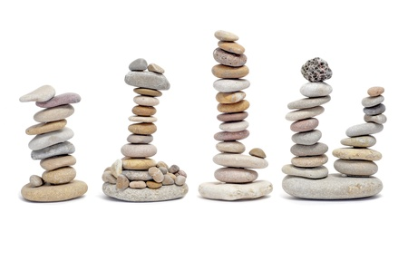 some piles of zen stones on a white background Stock Photo - 8755439