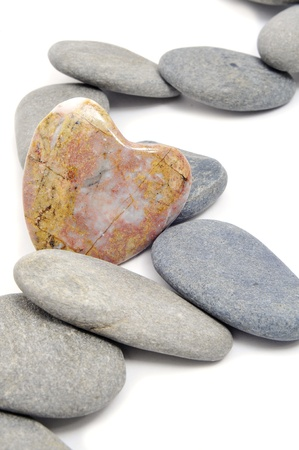 spirituality therapy: zen stones, one heart shapped, on a white background Stock Photo