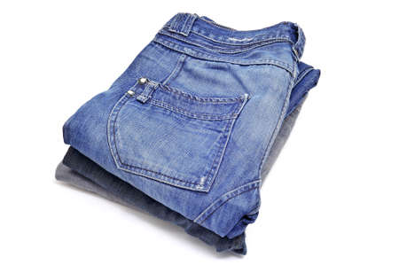 back pocket: a pile of blue jeans on a white background