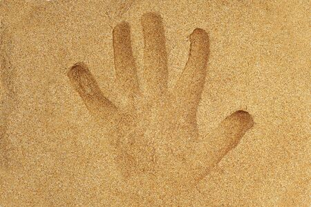 handprint in the sand of a beach Stock Photo - 8755475