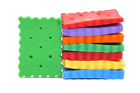 plasticine cookies of many colors on a white background photo