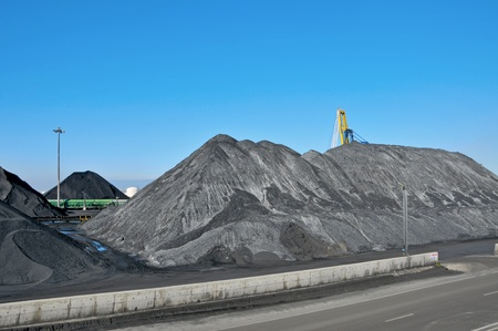 piles of cal at the facilities of a coal industry photo