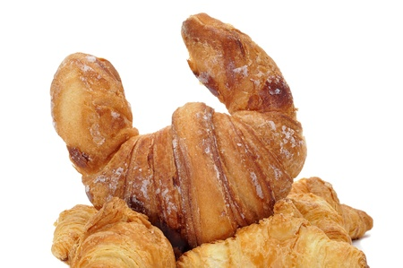 closeup of some croissants isolated on a white background Stock Photo - 8755668