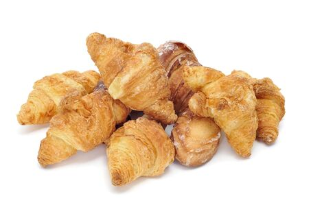 a pile of croissants isolated on a white background photo