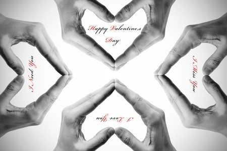man hands forming hearts and some sentences as happy valentines day photo
