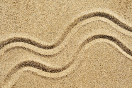 a wavy design drawn on the sand Stock Photo - 8755628