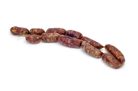 chorizos: red spanish chorizos string on a white background