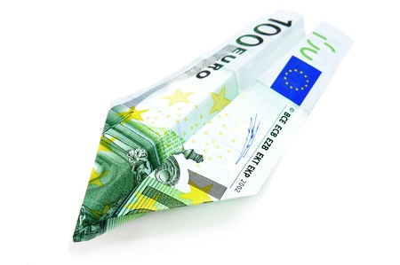 monetary devaluation: paper plane made with a 100 euro bill Stock Photo