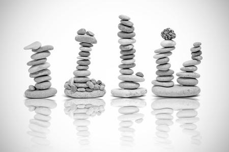 some piles of zen stones on a white background photo