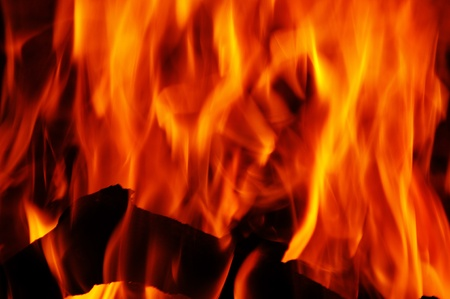 wood burning: closeup of red fire flames of a fireplace Stock Photo