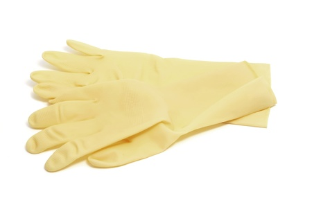 a pair of household rubber gloves isolated on a white background photo
