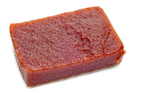 quince: a piece of dulce de membrillo, typical of Spain Stock Photo
