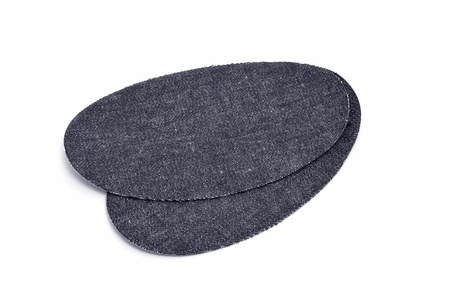 elbow pad: a pair of denim knee patches on a white background Stock Photo