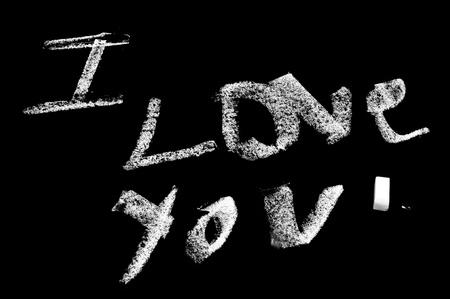 I love you written with chalk in a blackboard photo