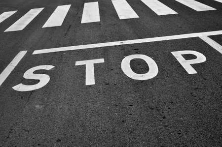 a stop sign painted on the road photo