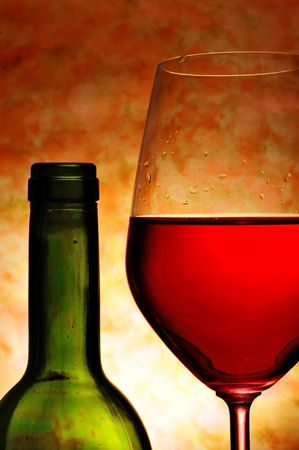 booze: closeup of a bottle and a glass with red wine