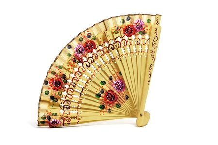 an ancient spanish hand fan on a white background photo