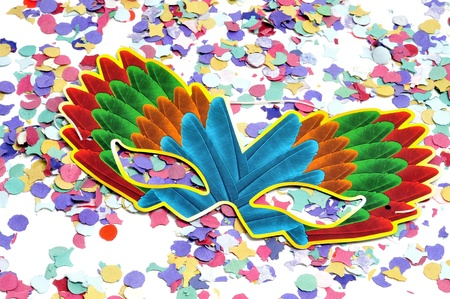 colorful carnival mask and confetti of different colors photo
