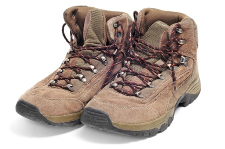 explorer man: a pair of hiking boots isolated on a white background