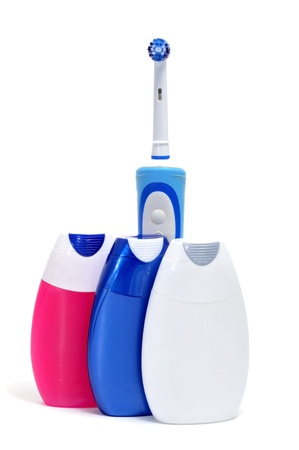 electric toothbrush and some toothpastes on a white background photo