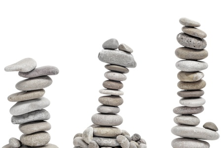 some piles of zen stones on a white background Stock Photo - 8981520