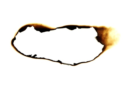 burn: burned hole on a white paper background