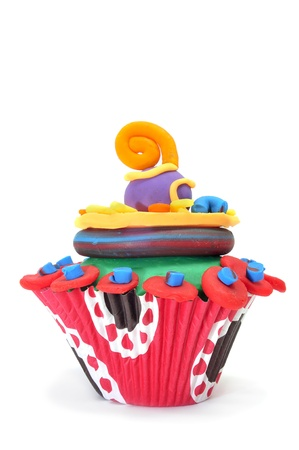 clay modeling: a frosted cupcake made in modelling clay on a white background