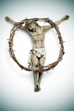 crown of thorns: a figure of Jesus Christ and a bloody crown of thorns