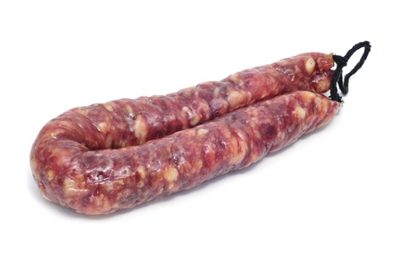 embutido: fuet, typical spanish cured sausage, on a white background