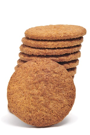 a pile of brown biscuits on a white background Stock Photo - 9142558