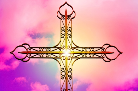 closeup of a wrought iron cross over the sky with the sunshine Stock Photo - 9142565