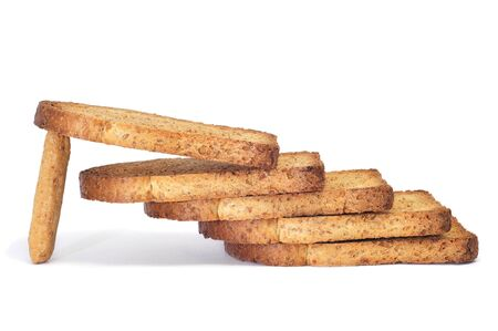 a pile of bread rusks on a white background photo