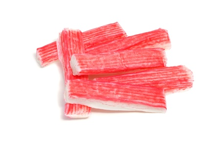 crabmeat: some red crab sticks on a white background Stock Photo