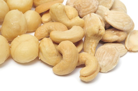 a pile of mixed nuts on a white background photo