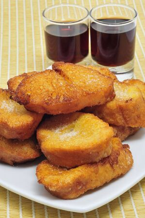 a pile of torrijas, typical Lent spanish sweet, and moscatel photo