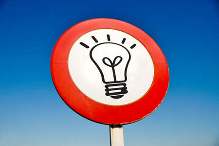 a light bulb drawn in a traffic sign symbolizing concept idea Stock Photo - 9178653