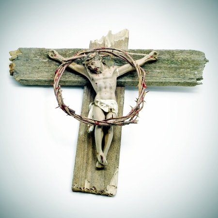 a figure of Jesus Christ in the cross and a bloody crown of thorns photo