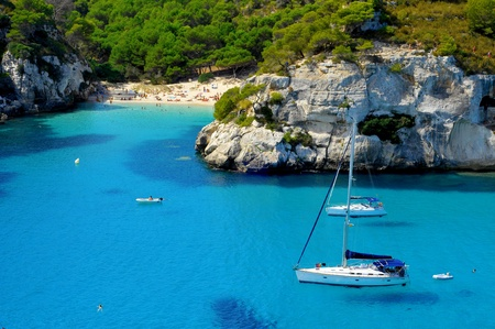 sail boat: view of Macarelleta beach in Menorca, Balearic Islands, Spain