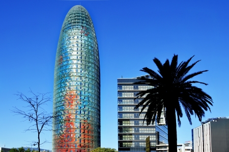 touristy: Barcelona, Spain - January 22, 2011: Torre Agbar and Technological District in Barcelona, Spain. This 38-storey tower was designed by the famous architect Jean Nouvel.