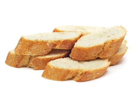closeup of a pile of bread slices on a white background