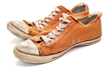 a pair of worn sneakers on a white background Stock Photo - 9258326