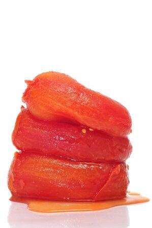 peeled: some whole peeled tomatoes on a white background