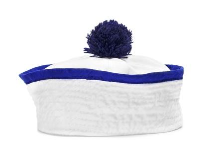 insolaci�n: una gorra de marinero sobre un fondo blanco