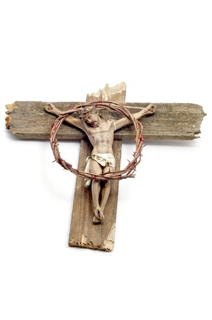 a figure of Jesus Christ in the cross and a bloody crown of thorns Stock Photo - 9299620