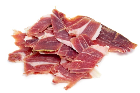 a pile of spanish serrano ham on a white background photo