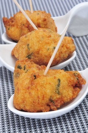 spanish food: some spanish cod fritters tapas ready to serve Stock Photo