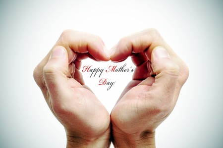 mother day: hands forming a heart and the sentence happy mothers day
