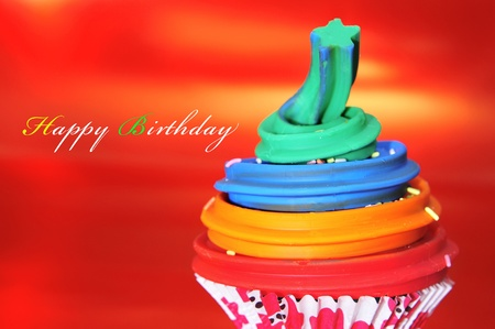 a cupcake on a red background with text happy birthday photo