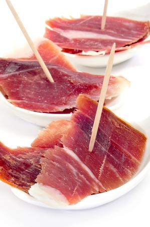 toothpick: closeup of a some spanish serrano ham tapas