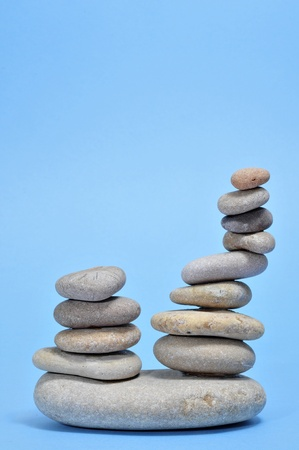 a pile of zen stones on a blue background Stock Photo - 9307364